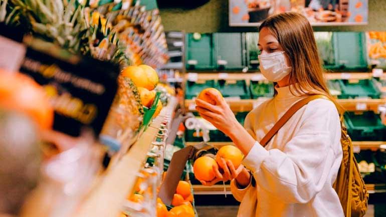 Comprando naranjas